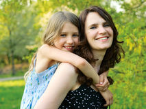 Girl and her mommy Stock Images