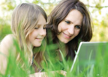Girl and her mommy outdoors Stock Image