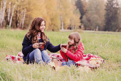 Girl and her mother in the autumn park Stock Photography