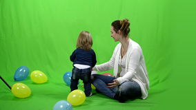 Girl with her mother and balloons on green screen 4k ProRes, 4.2.2, 10bit
