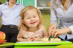 Girl and her mother cutting fruits Royalty Free Stock Photo