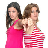 Girl and her mother doing thumbs down hand gesture Stock Images