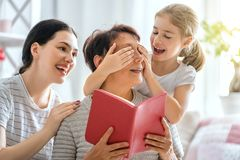 Girl, her mother and grandmother stock photography