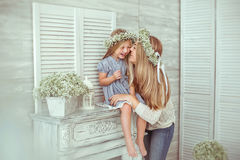 A girl and her mother are having fun together Stock Photo