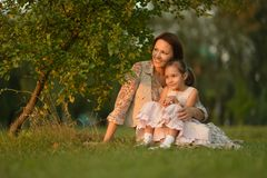 Girl with her mother Stock Image