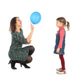 Girl and her mother playing with balloon stock image