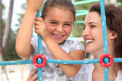 Girl and her mother playing Royalty Free Stock Photo