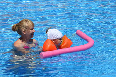 Girl with her mother in pool royalty free stock photo