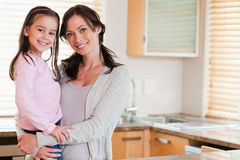 Girl and her mother posing Stock Photo