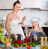Girl and her mother preparing healthy meal Royalty Free Stock Photography