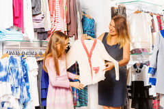 Girl and her mother shopping together in the store Royalty Free Stock Photo