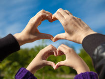 Girl and her mother show sign of heart with their hands Stock Photo