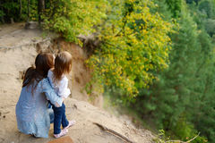 A girl and her mother standing on the edge Royalty Free Stock Photo