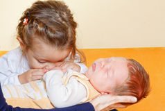 Girl with her newborn brother Stock Images