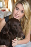 Girl with her pet dog. Girl with her pet flat coated retriever dog showing love and affection Stock Photo