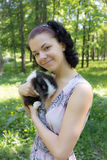 Girl with her pet rabbit Stock Images