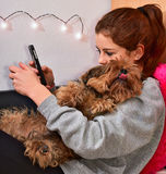 Girl with her pet. Teenager with his dog connected to social networks Royalty Free Stock Photography