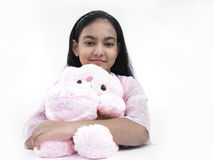 Girl with her pink teddy bear Royalty Free Stock Images