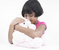 Girl with her pink teddy bear Stock Photo
