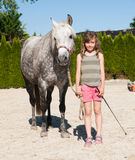 Girl with her pony. Girl before training with her pony Stock Photography