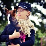 Girl with her puppy Stock Photography