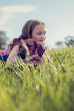 Girl with her puppy in the grass Stock Photo