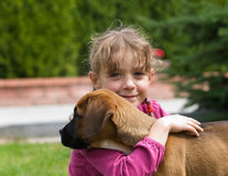 Girl and her puppy Stock Images