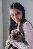 Girl and her Rabbit Stock Photo