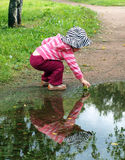 Girl and her reflection Stock Image