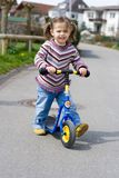 Girl on her scooter Royalty Free Stock Photos