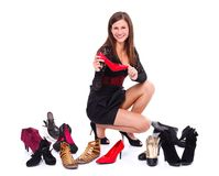 Girl with her shoes Royalty Free Stock Images