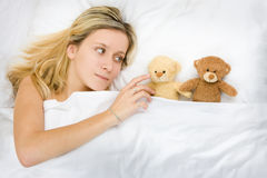 Girl and her stuffed animals royalty free stock photo