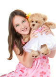 Girl with her teddy. Girl in pink hat and dress with her teddy Stock Photos