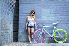Girl and her trendy bike Royalty Free Stock Images