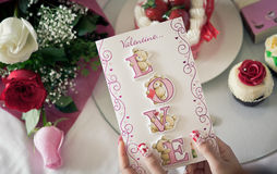 A girl and her valentine's day card Royalty Free Stock Image