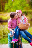 The girl and her younger sister in the nature near the river Royalty Free Stock Photography