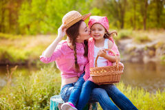 The girl and her younger sister in the nature near the river Royalty Free Stock Photo