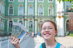 Girl with Hermitage tickets. A smiling teenage girl demonstrates tickets to the Hermitage Museum (St. Petersburg, Russia Royalty Free Stock Images