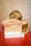 Girl hidden behind pile books Stock Photo