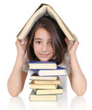 Girl hidden under a book Stock Photography