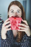 Girl hide behind christmas present box Royalty Free Stock Photos