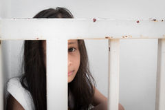 A girl is hide inside metal fence Stock Photography