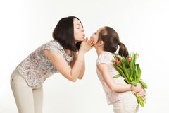 The girl hides a bouquet of flowers for mother Stock Images