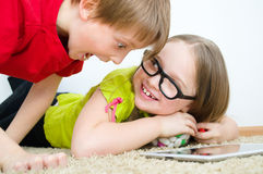 Girl hides candies from her brother Stock Photos