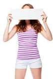 Girl hides her face behind the poster Stock Photos