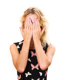 Girl hides her face in palms. Girl hides her face in two palms Stock Photo