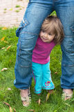 Girl hides for mother Stock Photos