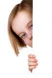 Girl hiding. Kid hiding behind white wall, isolated on a white background Royalty Free Stock Photos