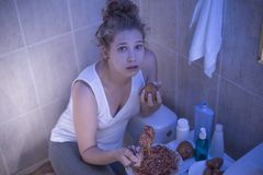 Girl hiding in bathroom Stock Photo