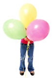 Girl hiding behind balloons Royalty Free Stock Photo